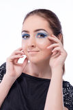 Beautiful girl with bright blue makeup Royalty Free Stock Photography