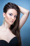Beautiful girl with bright blue makeup and jewelery Royalty Free Stock Photo