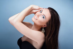 Beautiful girl with bright blue makeup and jewelery Royalty Free Stock Photos