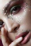 Beautiful girl with bright color makeup and crystals on the face. Close-up portrait. Royalty Free Stock Photo