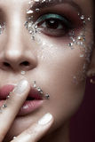 Beautiful girl with bright color makeup and crystals on the face. Close-up portrait. Royalty Free Stock Photos
