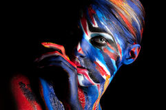 Beautiful girl with bright colored makeup. Creative. colored background Stock Photos