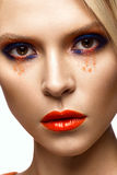 Beautiful girl with bright colored makeup and orange lips. Beauty face. stock images