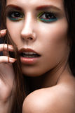 Beautiful girl with a bright colored makeup, wet Stock Photography