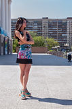 Beautiful girl in bright dress at urban background Royalty Free Stock Photography