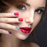Beautiful girl with a bright evening make-up and manicure with rhinestones. Nail design. Beauty face. Royalty Free Stock Image