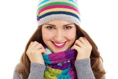Beautiful girl in bright hat and scarf Royalty Free Stock Photo