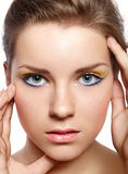 Beautiful girl with a bright make-up Stock Image