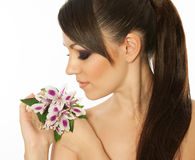 Beautiful girl with bright make-up and a flower. Royalty Free Stock Photography