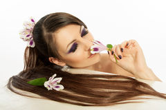 Beautiful girl with bright make-up and a flower. Royalty Free Stock Photo
