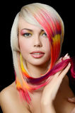 The beautiful girl with a bright make-up and multi-coloured stra Stock Photos
