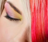 The beautiful girl with a bright make-up and multi-coloured strand in hair Stock Photography