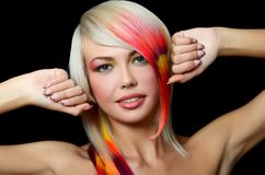 The beautiful girl with a bright make-up and multi-coloured strand in hair Stock Images