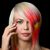 The beautiful girl with a bright make-up and multi-coloured strand in hair Royalty Free Stock Photography