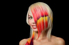 Beautiful girl with a bright make-up and multi-coloured strand in hair Royalty Free Stock Image