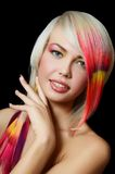 Beautiful girl with a bright make-up and multi-coloured strand in hair Royalty Free Stock Photography
