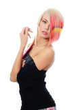 Beautiful girl with a bright make-up and multi-coloured strand in hair Stock Images