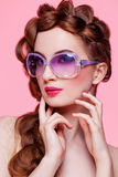 Beautiful girl with bright make-up and sunglasses Royalty Free Stock Image