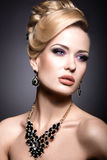 Beautiful girl with bright makeup and evening hairstyle. Royalty Free Stock Images