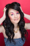 Beautiful girl with bright makeup and long curly hair Royalty Free Stock Photos