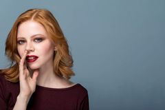 Beautiful girl with bright makeup telling a secret . Portrait young woman . Funny girl model whispering about something. Expressive facial expressions Stock Photos