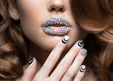 Beautiful girl with bright nails, lips of crystals Stock Image