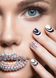 Beautiful girl with bright nails, lips of crystals Stock Images