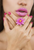 Beautiful girl with bright pink make-up and accessory close up. Stock Photo
