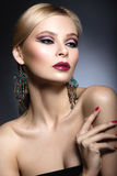 Beautiful girl with bright pink make-up and perfect skin. Beauty face. Festive image. Stock Photography