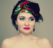 Beautiful girl. In a bright scarf royalty free stock photography