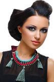Beautiful girl with bright vivid purple and green make-up Stock Photos