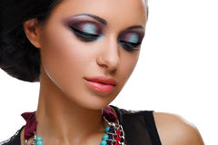 Beautiful girl with bright vivid purple and green make-up Royalty Free Stock Images