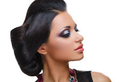 Beautiful girl with bright vivid purple and green make-up Stock Images