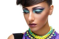 Beautiful girl with bright vivid purple make-up Stock Photo