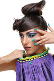 Beautiful girl with bright vivid purple make-up Royalty Free Stock Images