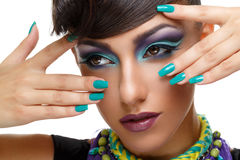 Beautiful girl with bright vivid purple make-up Stock Images