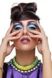 Beautiful girl with bright vivid purple make-up Royalty Free Stock Image