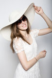 Beautiful girl in broad-brimmed hat posing and expresses different emotions. headache, sadness, fatigue.  Royalty Free Stock Photo
