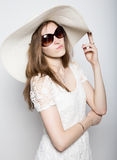 Beautiful girl in broad-brimmed hat posing and expresses different emotions. headache, sadness, fatigue.  Stock Photos