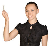 Beautiful girl broker holding sale house key. Royalty Free Stock Photos