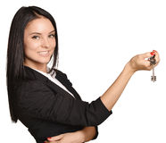 Beautiful girl broker holding sale house key. Royalty Free Stock Image