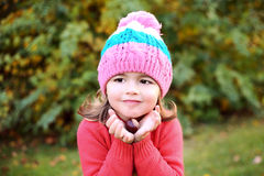 Beautiful girl with brown chestnut in autmn park Royalty Free Stock Photo