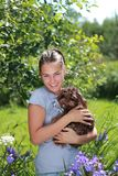 Beautiful girl with brown dog Stock Photo