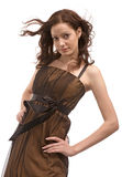 Beautiful girl in brown dress Stock Image