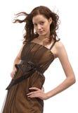 Beautiful girl in brown dress Stock Image
