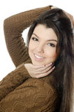 The beautiful girl in a brown sweater isolated Stock Photography