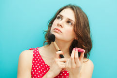 Beautiful girl with a brush and blusher Royalty Free Stock Photography