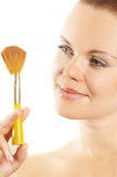 Beautiful girl about a brush for cosmetics royalty free stock photo