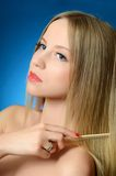 The beautiful girl brushes hair Royalty Free Stock Photos