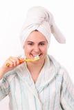 Beautiful girl brushes her teeth Royalty Free Stock Photos